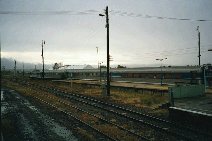 An XPT has stopped briefly under dark skies, before continuing its journey to Sydney.