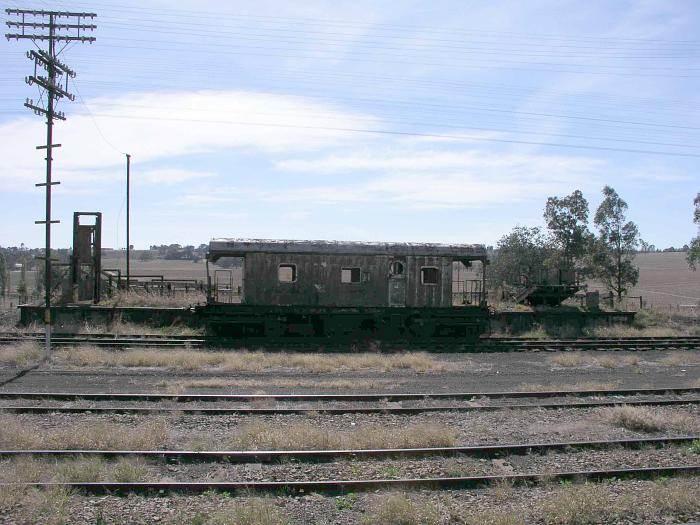 An old wagon sits in the siding adjacent to the stock platform.