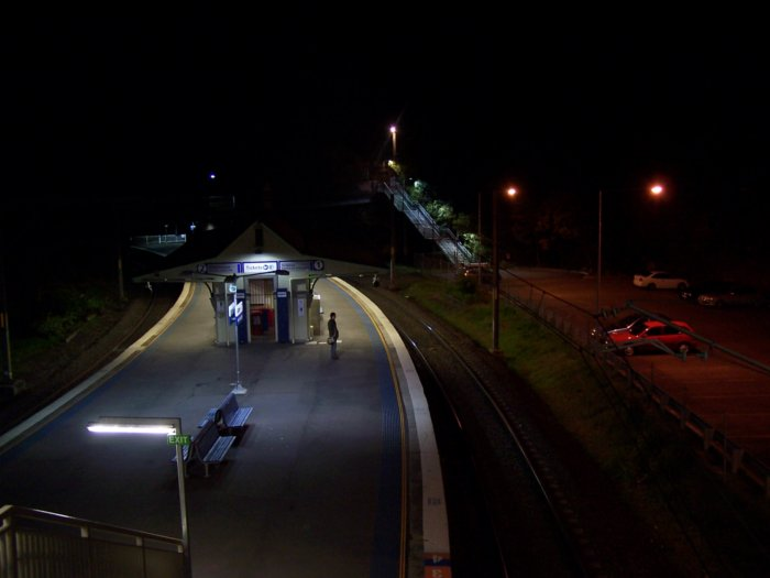 A night view looking down to the platform from the footbridge.