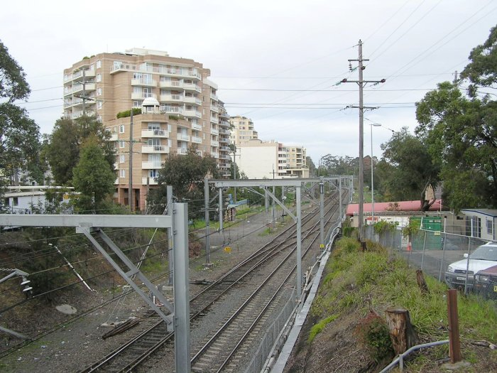 The view looking south from the Pacific Hwy overpass just south of Hornsby Station. The emergency crossover is located at the former level crossing over the line.