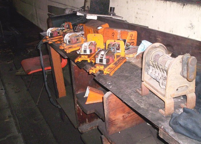 The electrician's bench with spare electric gear that make the levers release for for movement.