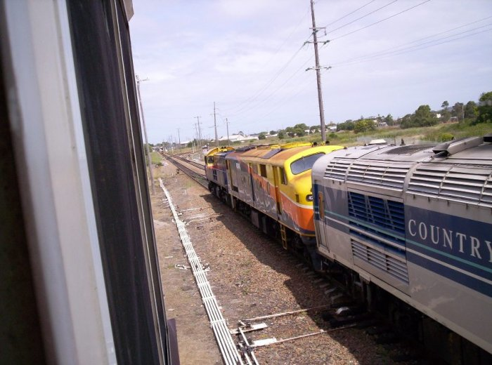 An XPT set being hauled by a pair of locos past the signal box.