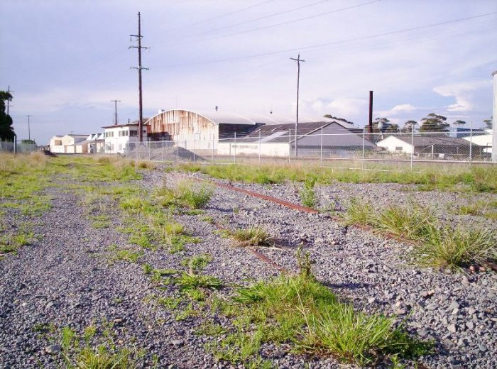 The one-time siding leading to the nearby gas works yard.  It is now disconnected from the main line.