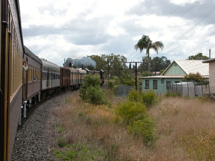 4908 and 4918 turn into the branch from the North Coast line pulling a tour train and some former Ritz Rail cars from Casino for delivery to Murwillumbah.