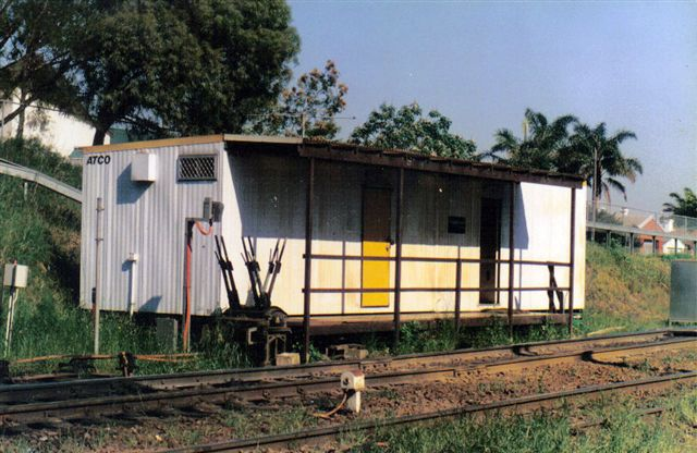 A photo of the Cooks River Yard master office with Frame 'A'. It was meant to be temporary But is still in used today (2007) as the yard master's office (Cooks River).  Frame 'A' has been removed with all points and signal now controlled from Sydenham signal complex.
