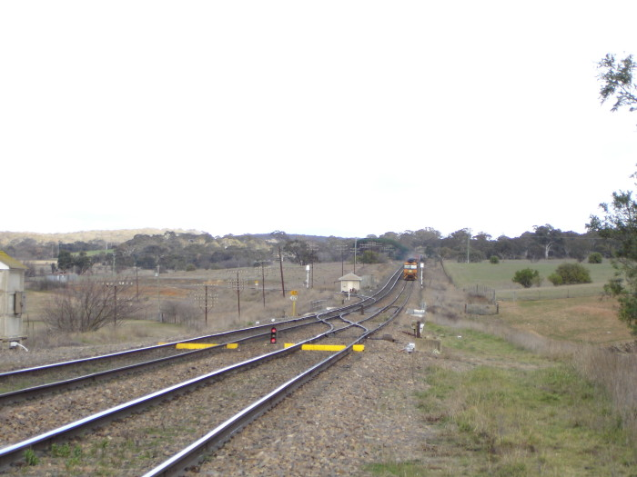The view looking down the line towards the junction. The yellow objects are dragging equipment detectors.