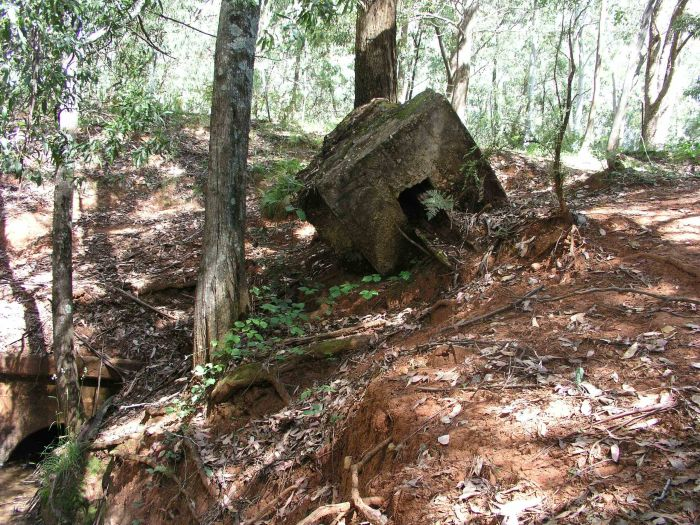 The remains of a culvert and the possible remains of the base of the Home Signal.