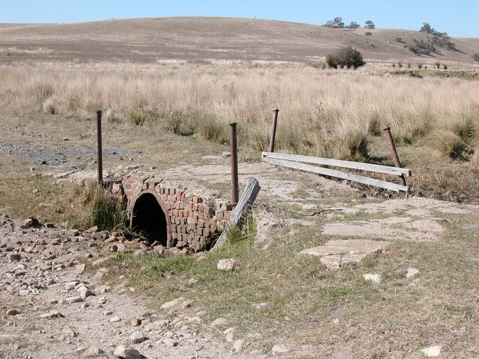 The brick culvert next to the main road.