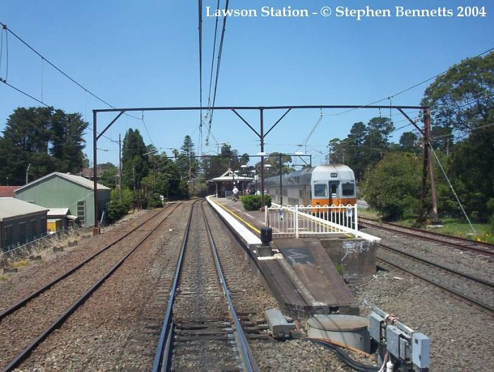 The view approaching the western end of the station from the front of an Up service from Lithgow. A down service V-Set is alongside platform 2.
