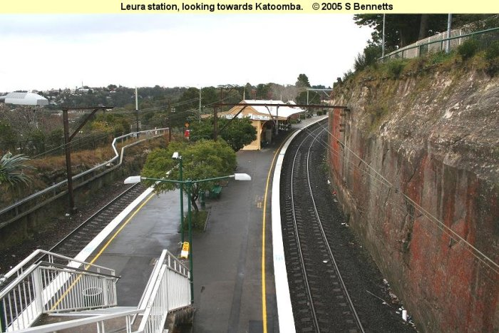 The view looking down from the footbridge towards Katoomba (westerly direction) which can be seen in the top left of photo. Platform 2 on left and Platform 1 and up main on right.