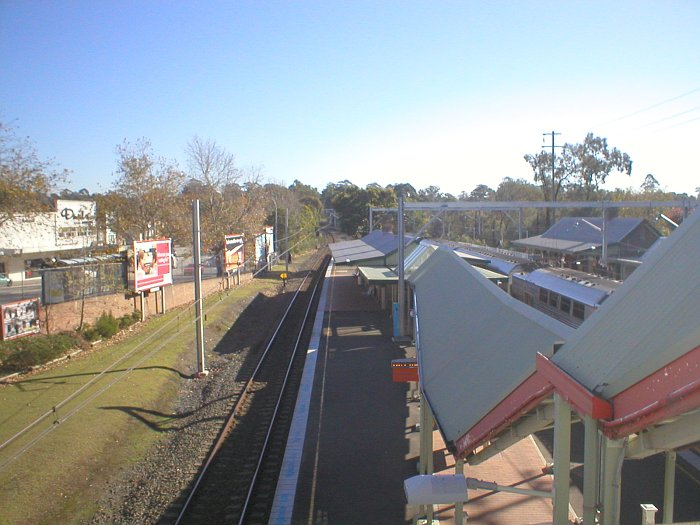 The view looking north along platform 3. The grass area to the left is the location of the former goods loop siding.