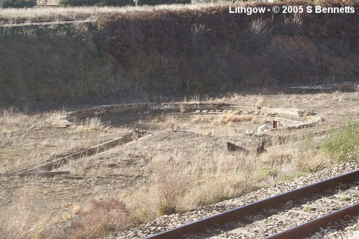 A photo of presumed turntable and ash pits located next to Up main between Eskbank and Coal Stage Box. This photo taken from Up train and at the top of this photo runs the line into the Lithgow State Mine. The Blast Furnace park is behind this view. Track in the foreground is an Up refuge that runs down through the shed next to Eskbank station.