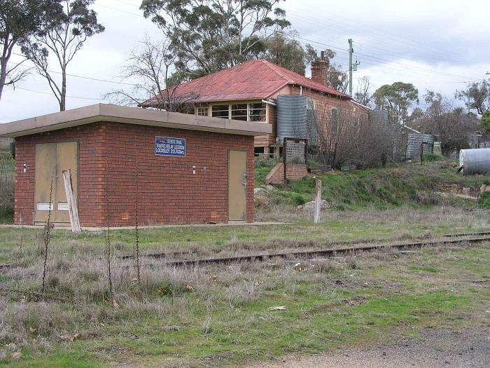 A modern electrical hut now stands where there used to be a goods shed served by a short siding.  The house is the former station masters residence.