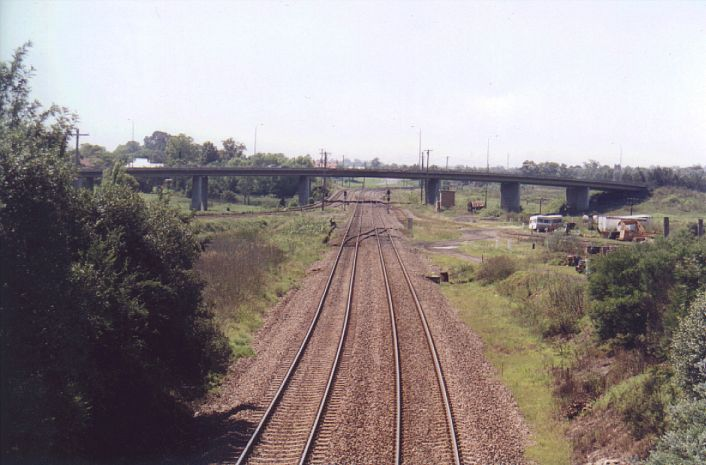Looking east towards Maitland Junctions.  The lines curving off in the left distance are the start of the North Coast line.  Coming in from the right is the start of the Cessnock Branch.