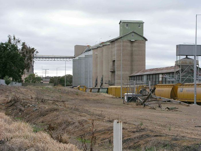 The silos at Manildra, with the former station-master's residence on the far left.