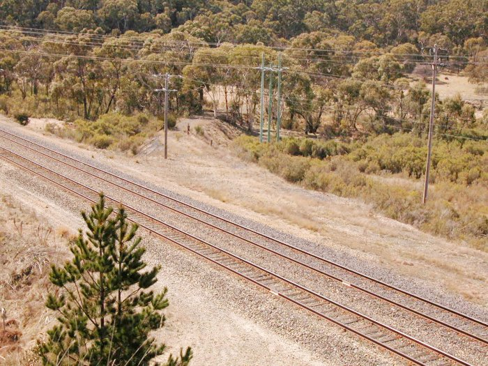 The former junction of the Commonwealth Siding, which left the Up Main in a trailing junction, before curving around to the right and leading to the Marrangaroo Army Base.