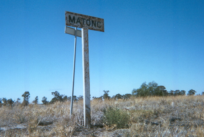 The platform at Matong still supports two station name signs but the better of the two faces the road rather than the tracks.
