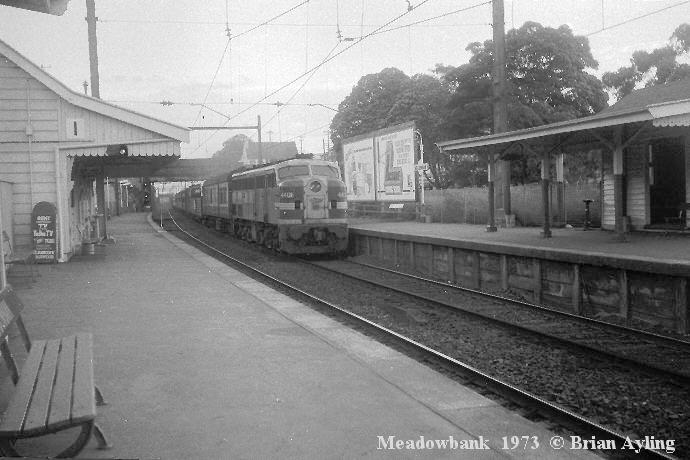 Timber waiting rooms adorned both platforms at Meadowbank in this view looking south in 1973. The ticket office was at the left, out of view. The building visible above the locomotive is a railway residence which stands on the site of the current day commuter car-park. The original Parramatta River bridge can be seen in the distance.