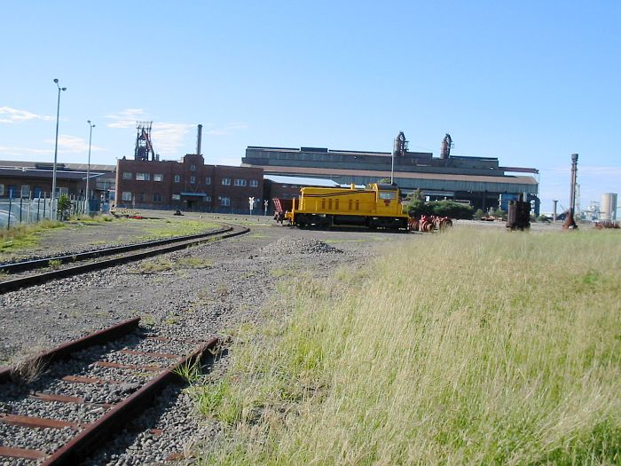 A shunting loco sits inside the former BHP site.