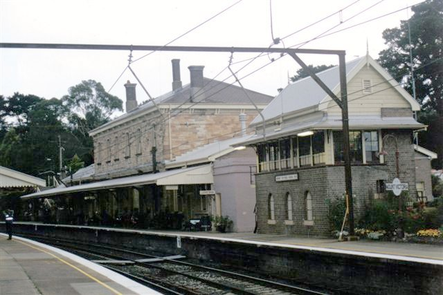 The view looking across to the two-storey station building and signal box.