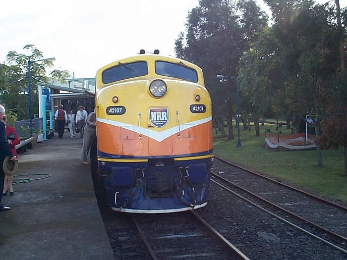 Ex-State Rail unit 42107, now owned by the Northern River Railway, stands at the station at the head of the Ritz Rail tourist train.