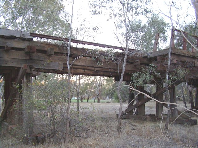 The trestle is in poor condition in places where the decking and sleepers have rotted leaving the rail line suspended in mid air - a view taken on the northern bank of the Murrumbidgee River.