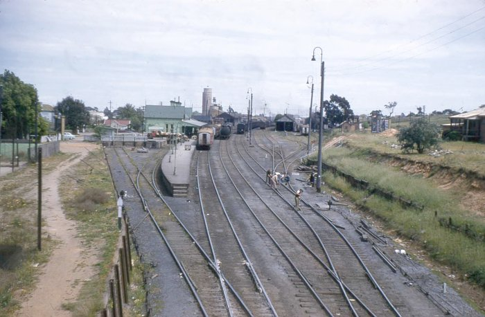 The view looking down the line towards the station.  On the left is the dock siding, with the main, loop and back roads opposite the platform. The sidings on the far right leads to the Rail Motor shed (dark building) and the loco facilities.  In the distance is the Wise Brothers Mill.