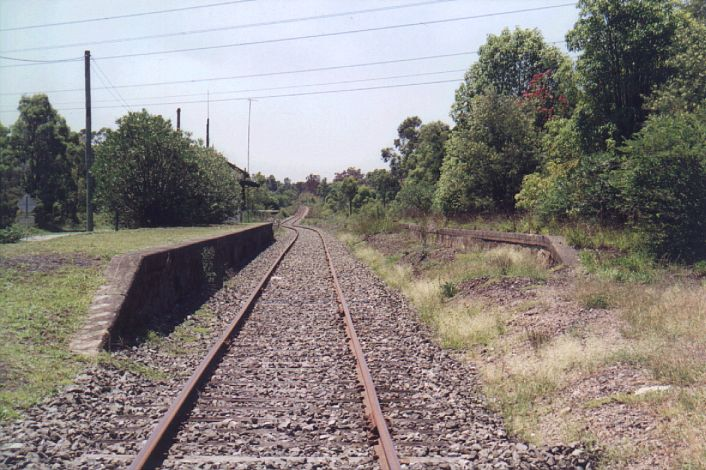 The view along the platforms in the up direction.  The signal box is just visible behind the bushes on the left.