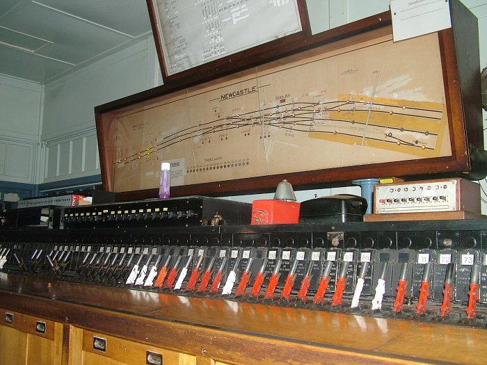 The track diagram and minature lever panel inside the signal box.