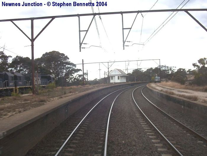 The view looking towards Sydney. The signal box was cut in and a coal train from the nearby Clarence Colliery can be seen on the left waiting for its path to Port Kembla.