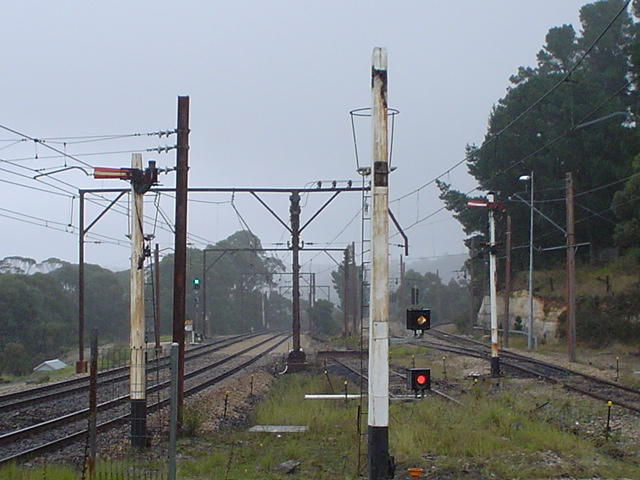 The view looking west. In recent times the refuge loop on the right has been disconnected from the main line. The signals on the post have ben removed and replaced with fixed stop lights.