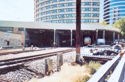 The view looking north towards the undercover North Sydney station. A city-bound service is just leaving platform 1.