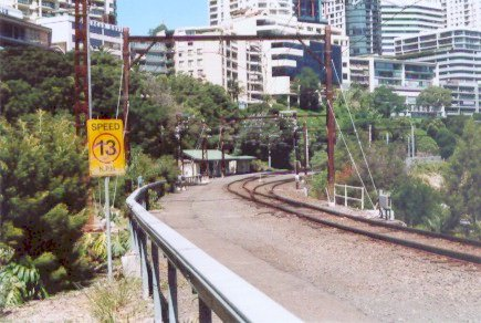 The view looking towards an empty North Sydney car siding. Photograph taken from the access walkway for the railway workers from Clark Park, North Sydney looking towards Milson Point.