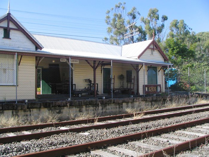 A close up shot of the station building.  The line to Murwillumbah runs away to the right.