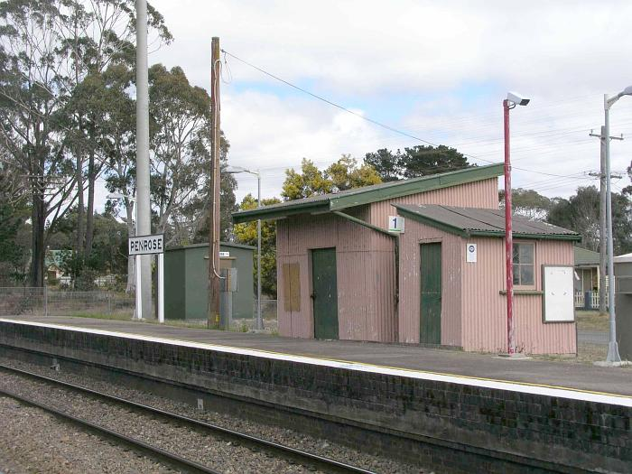 A view of the up platform complete with ramshackle corrugated iron sheds.