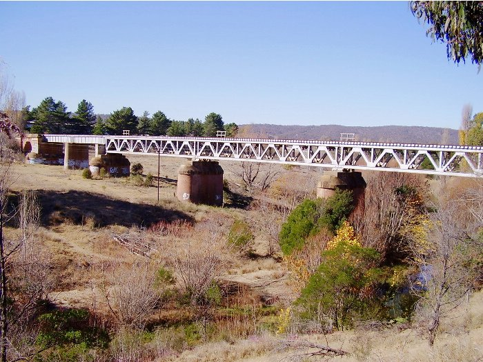 A view of the northern side of the single line bridge over the Queanbeyan River.