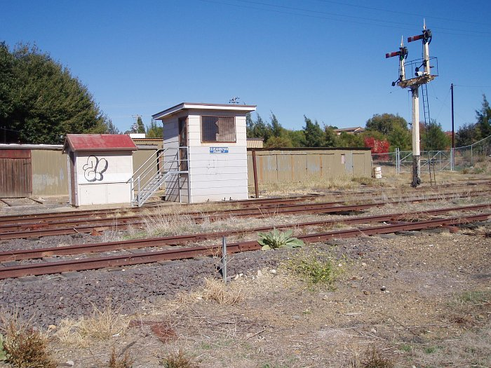 A side-on view of the F Frame signal box, with the gangers shed behind.