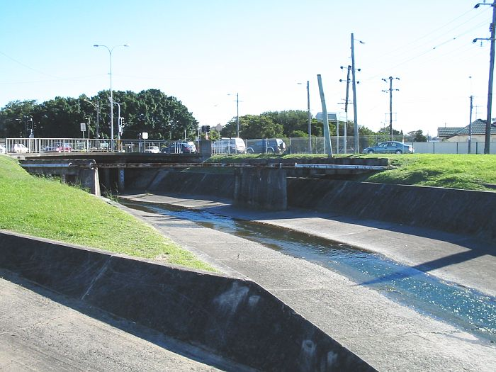The concrete supports in the stormwater channel are where the branch line crossed over adjacent to Griffiths Road Broadmeadow.