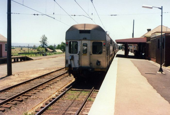 An electric train has stopped at Riverstone, at the time the limit for electrification of the line.
