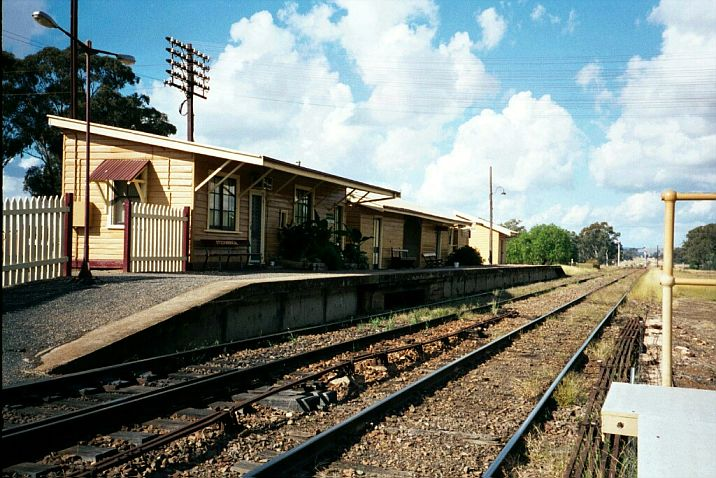 The platform and station, looking in the direction of Cootamundra.  The station shares its unusual architecture with Canowindra.