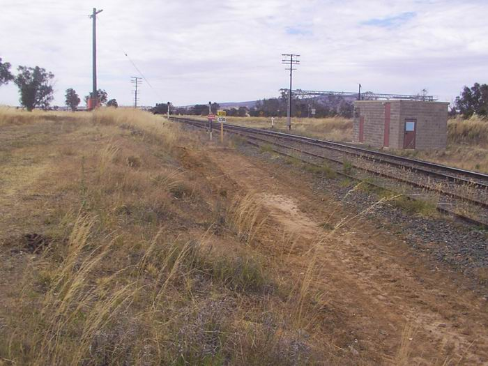 The station was situated on the opposite (down) side of the line.  No trace remains today.