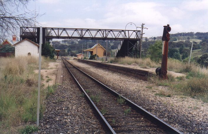The view from the up end of the station showing the truncated water column (the water tank is out of sight behind the left end of the footbridge).