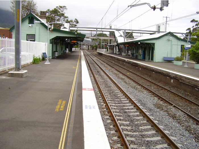 View from the up platform at Thirroul looking towards Sydney with the island platform for down trains and local services on the right.
