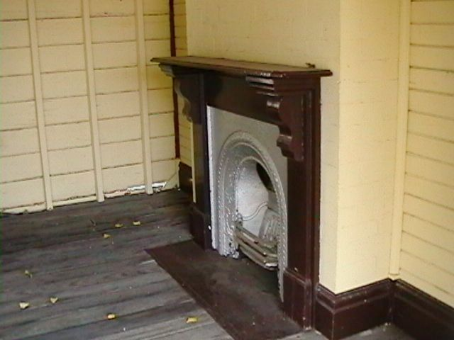 The fireplace still remains within the waiting room.