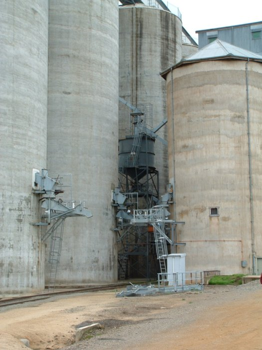 The grain silos dwarf the track and loading facilities.