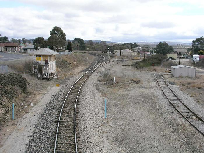 The view looking west towards the old Wallerawang West signal box and the junction of the line to Gwabegar.  The siding is now used for per-way storage.  The area to the right of the main line was once the site of extensive loco service facilities include ash and inspection pits, a water tank, coal stage and a 60' turntable.