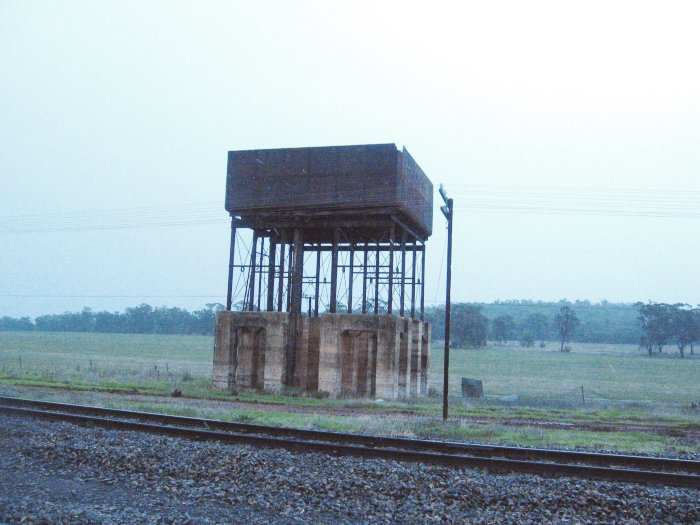 The elevated water tank, with a piece of the corner missing, presumably due to a lightning strike.