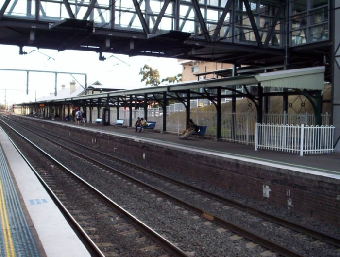 The covered waiting area on the Up platform at Wollongong. Viewed looking back towards Bomaderry.