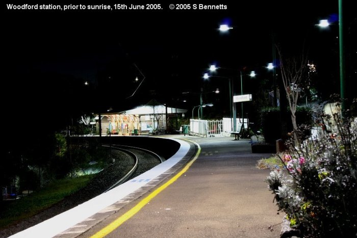 A night shot taken from the western end of platform 1 looking east down the Up main towards Sydney.