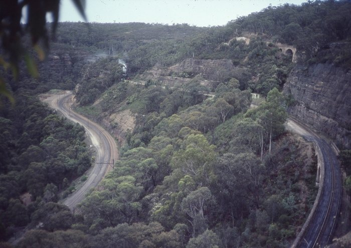 All three roads of the Zig Zag can be seen here. The smoke is from a train emerging from the tunnel on the middle road.